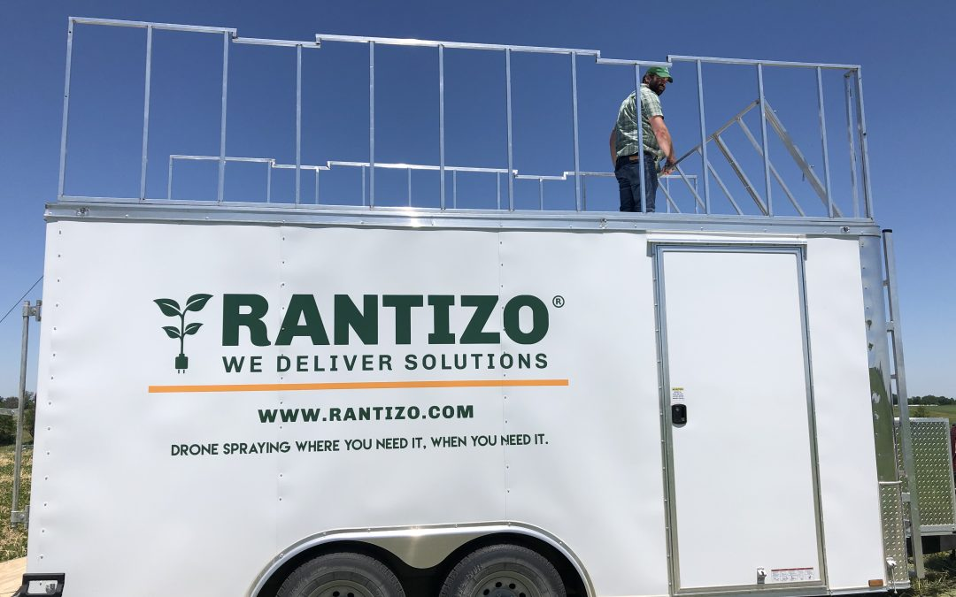 Rantizo Director of Technology, Mike Schmitz setting up the Rantizo Load & Go trailer for drone spraying